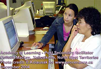 Computer Teaching Lab at Yellowknife's Post Secondary - Academy of Learning showing newly qualified Colleen MacKay working with student